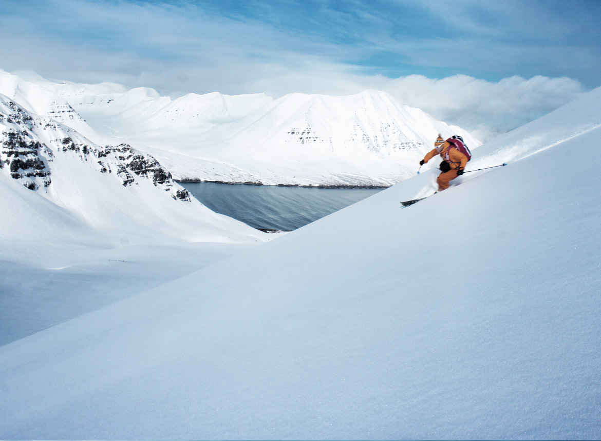 Ski guide Sigi Rumpfhuber opens a line above Iceland's Olafsfjord